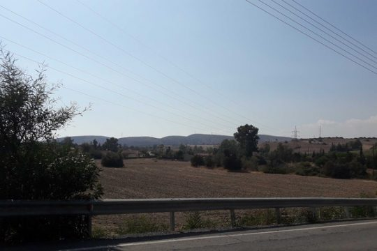 Large field in the village of Moni