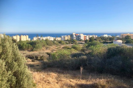 Three attached pieces of land for sale in Agios Tychonas near the highway and the beach